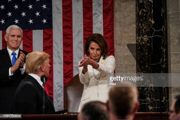 Speaker Nancy Pelosi and Vice President Mike Pence applaud US President Donald Trump at the State of the Union address in the chamber of the US House...