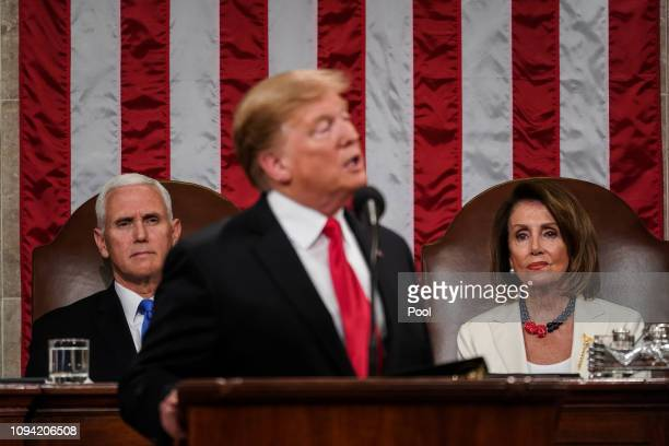 Speaker Nancy Pelosi and Vice President Mike Pence look on as US President Donald Trump delivers the State of the Union address in the chamber of the...