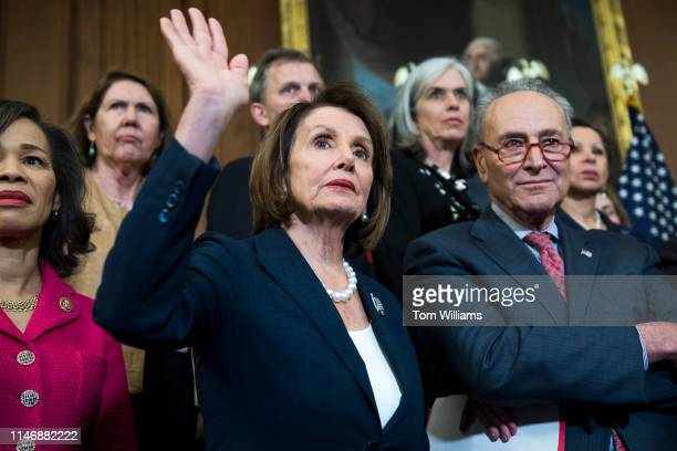 Speaker Nancy Pelosi DCalif and Senate Minority Leader Charles Schumer DNY are seen during a rally in the Capitol Building to call on the Senate to...