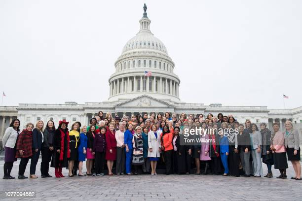 Speaker Nancy Pelosi DCalif center poses with Democratic women members of the House after a group photo on the East Front of the Capitol on January 4...