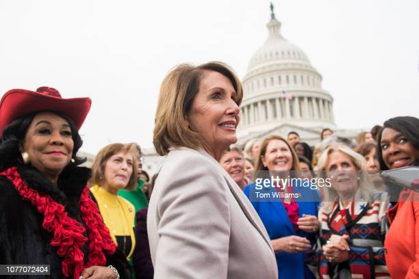 Speaker Nancy Pelosi DCalif talks with Democratic women members of the House after a group photo on the East Front of the Capitol on January 4 2019