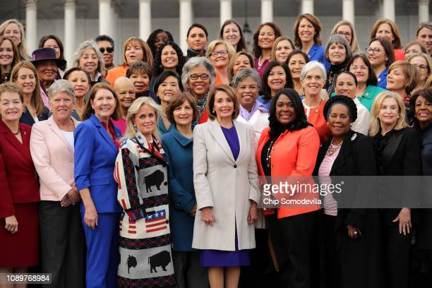 Speaker Nancy Pelosi poses for photographs with all of her fellow House Democratic women in front of the US Capitol January 04 2019 in Washington DC...
