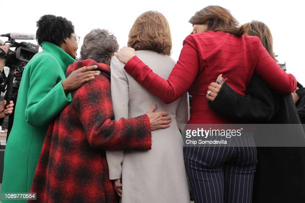 Speaker Nancy Pelosi poses for photographs with members of the Illinois delegation including Rep Lauren Underwood Rep Jan Schakowsky and Rep Sheri...