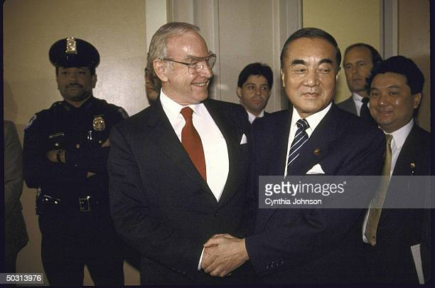 US Speaker of the House James C Wright Jr shaking hands with Japan's Prime Minister Yasuhiro Nakasone