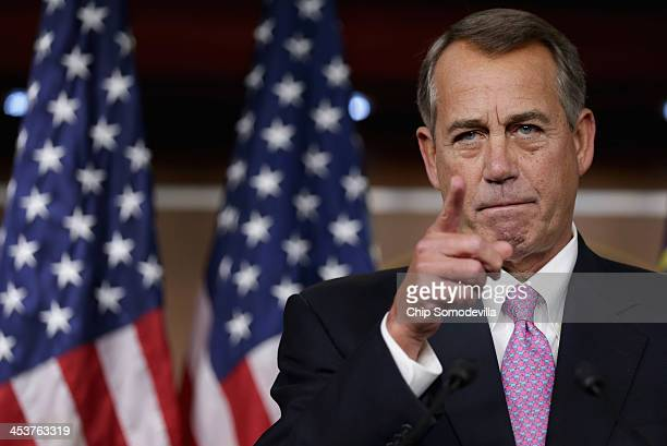 Speaker of the House John Boehner answers reporters questions during his weekly news conference in the Capitol Visitors Center at the US Capitol...