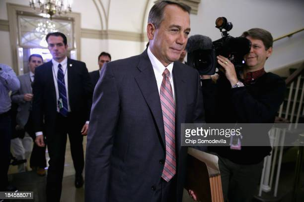 Speaker of the House John Boehner arrives at the US Capitol on the 14th day of the partial federal government shutdown October 14 2013 in Washington...