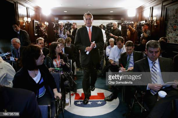Speaker of the House John Boehner arrives for a news conference after a House GOP caucus meeting at the Republican National Committee headquarters on...