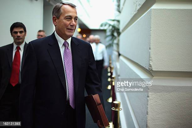 Speaker of the House John Boehner arrives for the weekly House Republican caucus meeting at the US Capitol March 5 2013 in Washington DC With the...