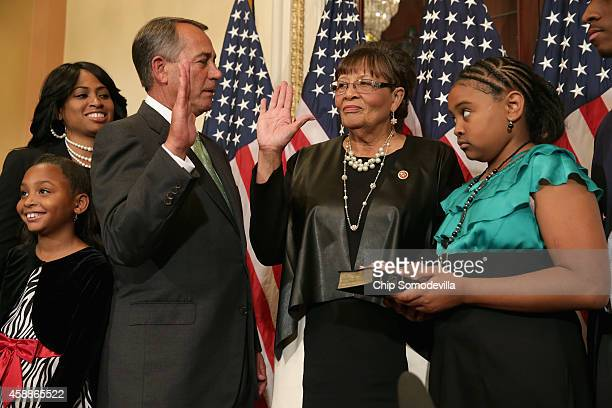 Speaker of the House John Boehner ceremonially swearsin Representativeelect Alma Adams as her family looks on at the US Capitol November 12 2014 in...