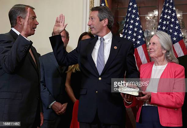 Speaker of the House John Boehner conducts a ceremonial swearingin with US Rep Mark Sanford and his mother Peggy Sanford at the US Capitol May 15...