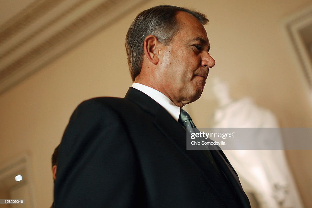 Speaker of the House John Boehner (R-OH) heads to the House floor to address members on the 'fiscal cliff' negotiations with the White House and Congressional Democrats at the U.S. Capitol December 11, 2012 in Washington, DC. Boehner's office said he will announce that negotiations are making headway toward averting the automatic steep tax hikes and spending cuts set for the end of the year.