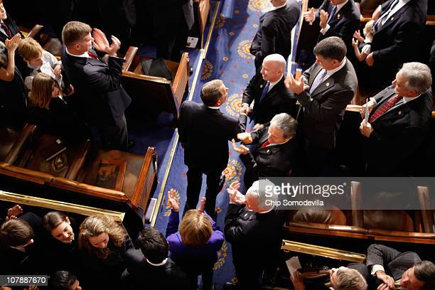 Speaker of the House John Boehner is congratulated by colleagues while entering the House chamber following his election January 5 2011 in Washington...