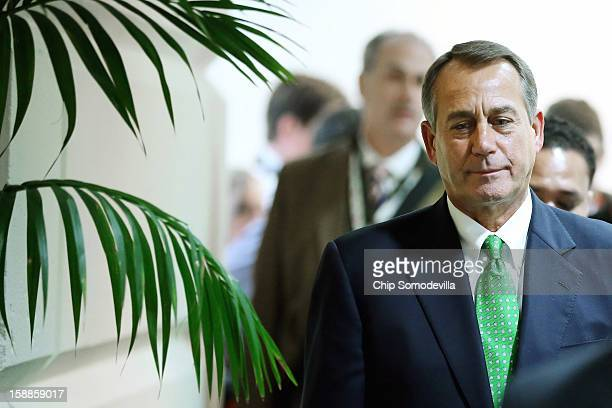 Speaker of the House John Boehner leaves a House Republican Caucus meeting where members considered the legislation that is supposed to blunt the...