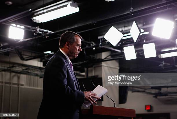 Speaker of the House John Boehner leaves after a news conference where he announced that he and Senate Majority Leader Harry Reid had negotiated deal...
