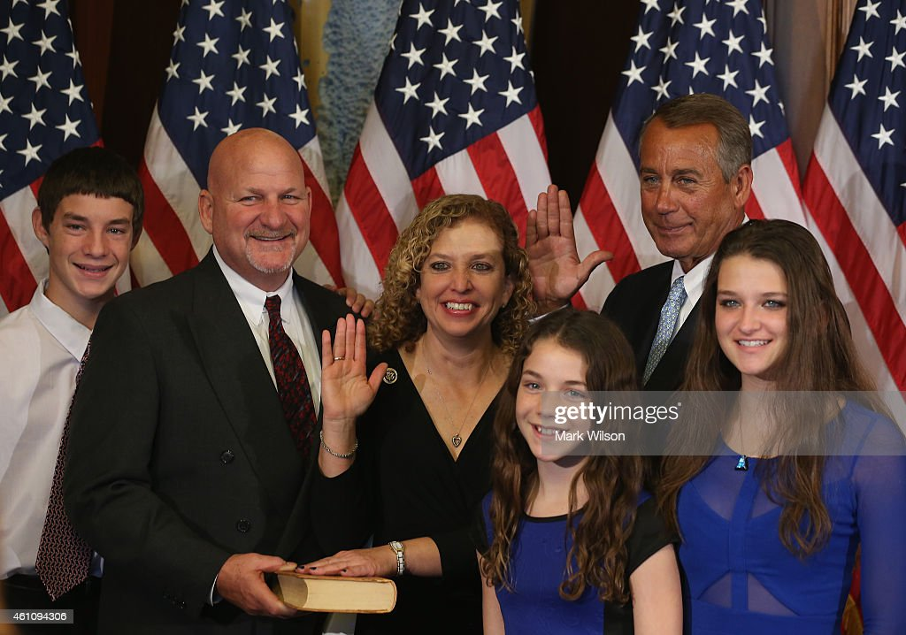 Speaker of the House John Boehner (R-OH)(R) poses with Rep. Debbie Wasserman Schultz (D-FL) (C) and her family during a ceremonial swearing in at the US Capitol January 6, 2015 in Washington, DC. Today Congress convened its first session of the 114th Congress with Republicans controlling both the House and Senate.