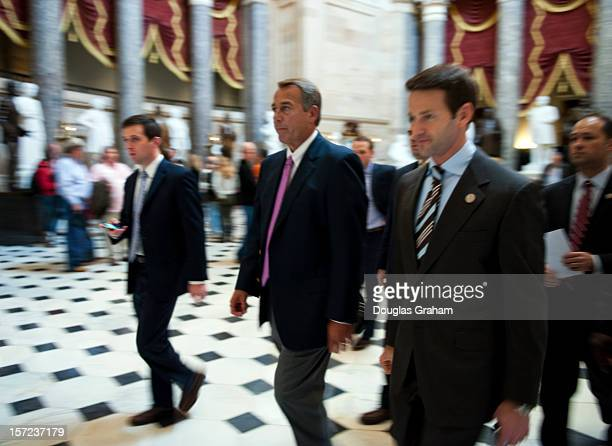 Speaker of the House John Boehner ROH and Rep Aaron Schock RIL make their way through Statuary Hall on the House side of the US Capitol on November...