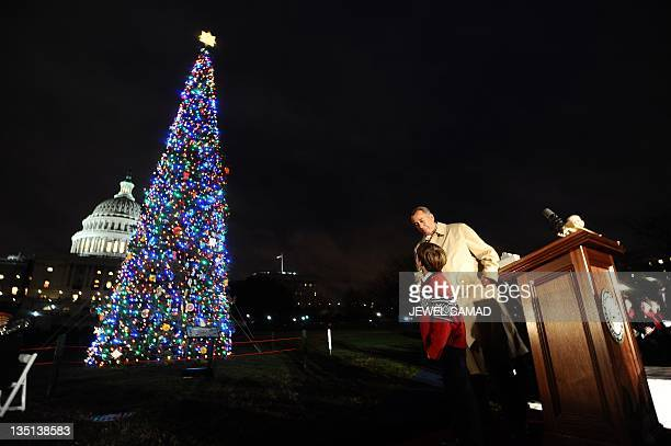 US Speaker of the House John Boehner ROH lights the 2011 Capitol Christmas Tree with sevenyearold Johnny Crawford of Sonora California on the West...