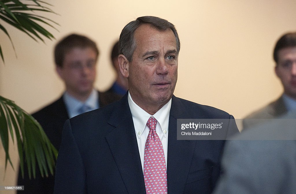 Speaker of the House John Boehner, R-Ohio, leaves a GOP conference meeting at the Capitol. Congressional leaders are here this evening still trying to hammer out a deal for the 'Fiscal Cliff.'
