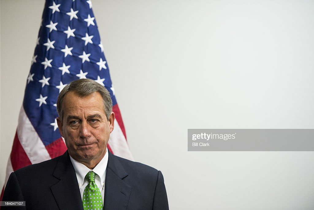 Speaker of the House John Boehner, R-Ohio, listens as other House Republican leaders speak during their media availability after the House Republican Conference meeting in the basement of the Capitol on Tuesday, March 19, 2013.