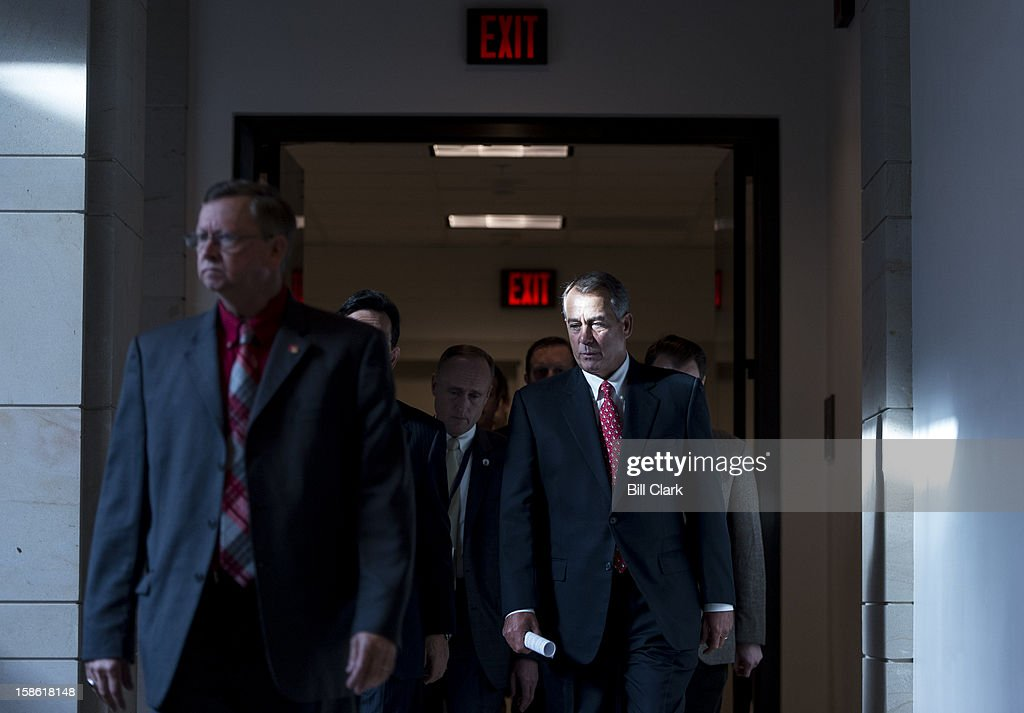 Speaker of the House John Boehner, R-Ohio, makes his way to his news conference to speak about the fiscal cliff and the failed Plan B on Friday, Dec. 21, 2012.