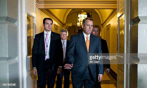 Speaker of the House John Boehner ROhio walks to the House Republican Conference meeting in the Capitol to discuss the Senate deal to end the...