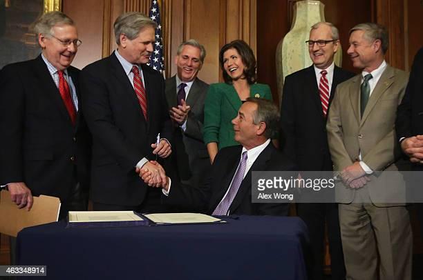 Speaker of the House John Boehner shakes hands with Sen. John Hoeven as Senate Majority Leader Sen. Mitch McConnell , House Majority Leader Rep....