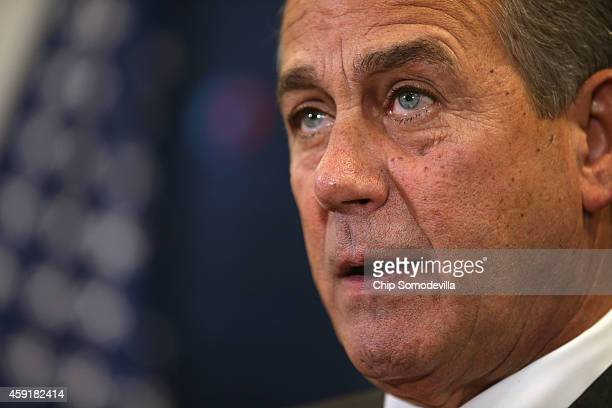 Speaker of the House John Boehner talks to reporters after the weekly House Republican caucus meeting at the US Capitol November 18 2014 in...