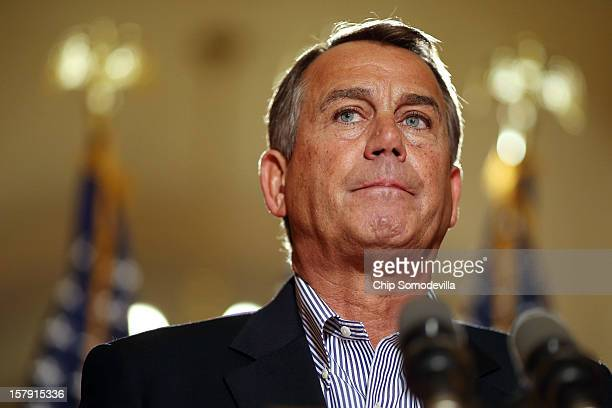 Speaker of the House John Boehner talks with reporters outside his office in the US Capitol December 7 2012 in Washington DC Boehner said he could...