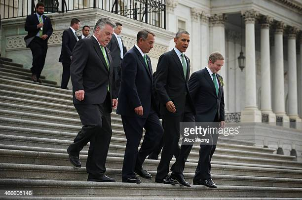 Speaker of the House John Boehner US President Barack Obama and Irish Prime Minister or Taoiseach Enda Kenny walk down the steps of the House of...