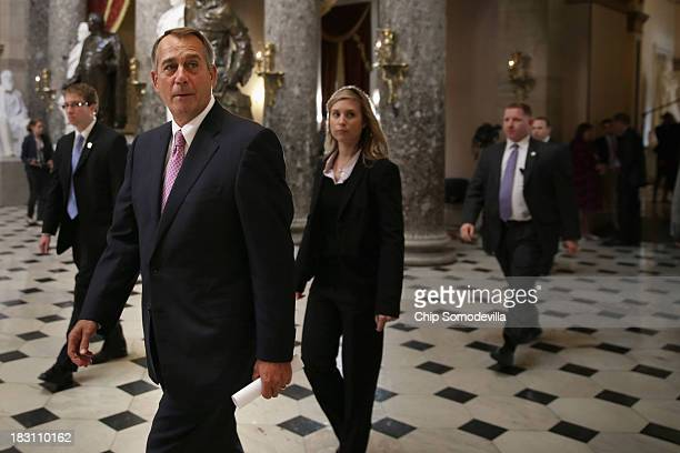 Speaker of the House John Boehner walks through Statuary Hall to his office after a series of proceedural votes at the US Capitol October 4 2013 in...