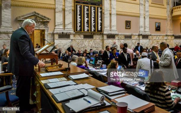 Speaker of the House Mike Busch left reaches for his gavel to call the evening session to order on the last day of the Maryland state legislature on...