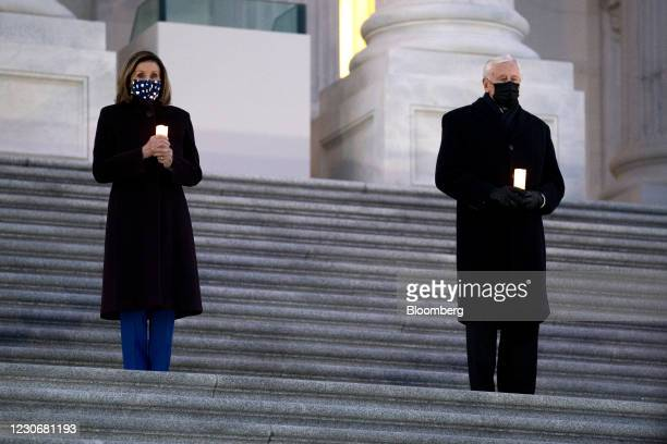 Speaker of the House Nancy Pelosi, a Democrat from California, left, and House Majority Leader Steny Hoyer, a Democrat from Maryland, wear protective...