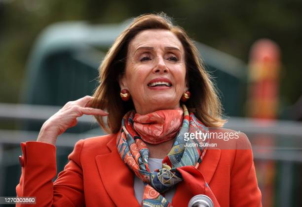 Speaker of the House Nancy Pelosi adjusts her hair as she speaks during a Day of Action For the Children event at Mission Education Center Elementary...
