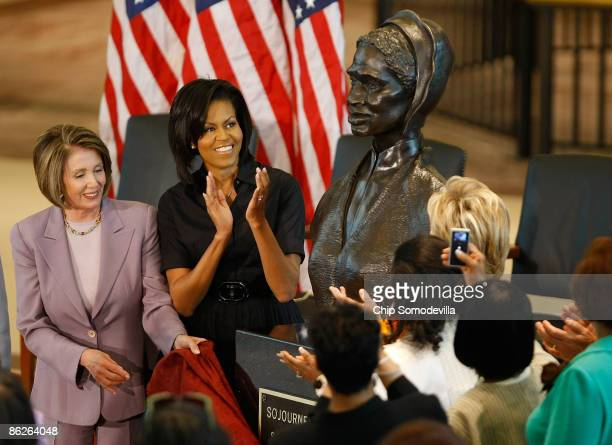 Speaker of the House Nancy Pelosi and first lady Michelle Obama applaud after the unveiling of the bust of Sojourner Truth in the US Capitol Visitors...