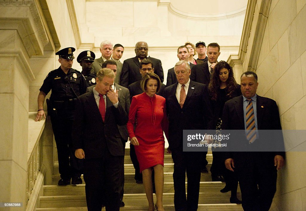 Speaker of the House Nancy Pelosi (D-CA) (2L) and House Majority Leader Steny Hoyer (D-MD) (2R) walk with others after leaving a caucus meeting with President Barack Obama on Capitol Hill November 7, 2009 in Washington, DC. US President Barack Obama spoke with members of the House Democratic Caucus about healthcare reform legislation which is expected to be voted on today.