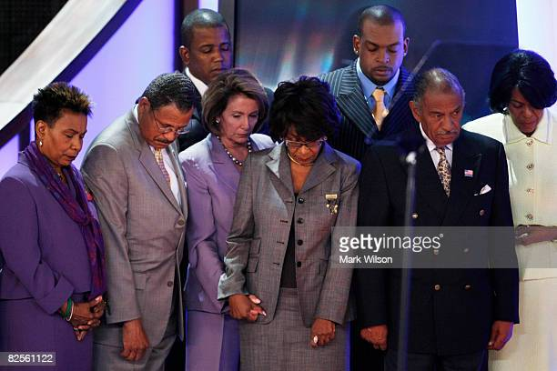 Speaker of the House Nancy Pelosi and members of the Congressional Black Caucus bow their heads during an in memoriam presentation on day two of the...