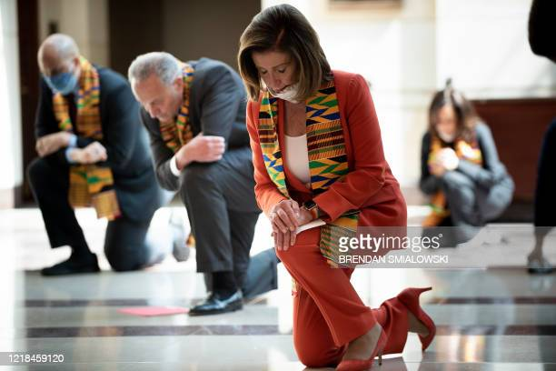 Speaker of the House Nancy Pelosi and other Democratic lawmakers take a knee to observe a moment of silence on Capitol Hill for George Floyd and...