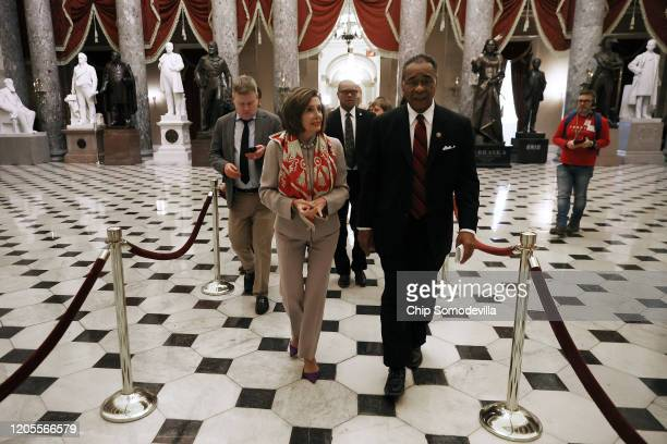 Speaker of the House Nancy Pelosi and Rep Emanuel Cleaver walk back to Pelosi's office after settling their friendly wager on the Super Bowl in The...
