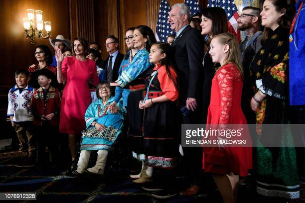 Speaker of the House Nancy Pelosi and Representative Deb Haaland DNM pose during a mock swearing in at the beginning of the 116th Congress on Capitol...