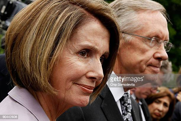 Speaker of the House Nancy Pelosi and Senate Majority Leader Harry Reid talk to members of the news media outside the West Wing after meeting with US...