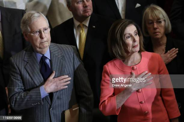 Speaker of the House Nancy Pelosi and Senate Majority Leader Mitch McConnell stand for the presentation of colors during a Congressional Gold Medal...