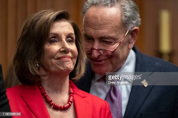 Speaker of the House Nancy Pelosi and Senate Minority Leader Chuck Schumer speak with each other at a press conference with DACA recipients to...