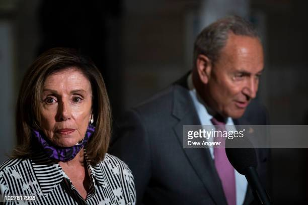 Speaker of the House Nancy Pelosi and Senate Minority Leader Chuck Schumer speak to reporters in Statuary Hall after they met with U.S. Treasury...