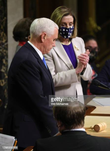 Speaker of the House Nancy Pelosi and Vice President Mike Pence look on after the conclusion of the count of electoral votes in the House Chamber...