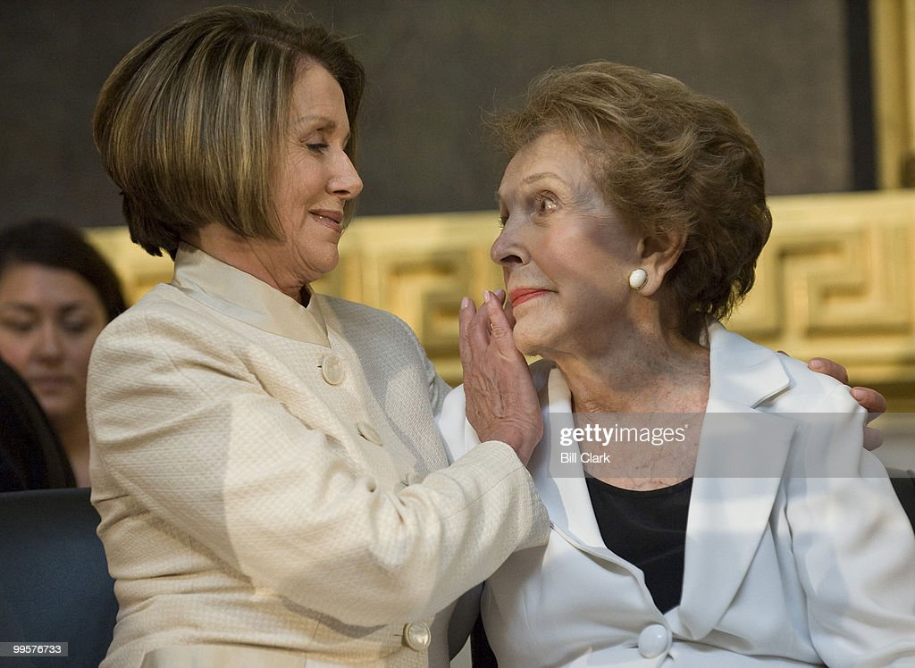 Speaker of the House Nancy Pelosi, comforts former First Lady Nancy Reagan after her emotional speech during the ceremony to unveil a statue of former President Ronald Reagan that will become part of the National Statuary Hall Collection on in the U.S. Capitol on Wednesday, June 3, 2009.