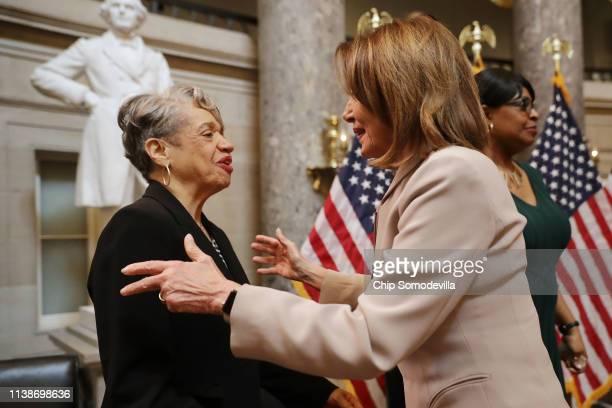 Speaker of the House Nancy Pelosi congratulates NASA mathematician and aeronautical engineer Dr Christine Darden during an event honoring NASA's...