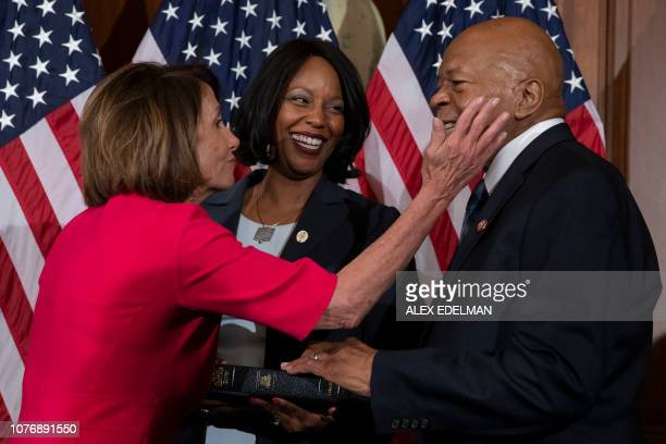 Speaker of the House Nancy Pelosi DCA congratulates incoming Chair of the House Oversight Committee Elijah Cummings and wife Maya Rockeymoore during...