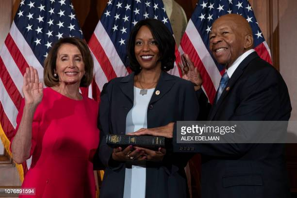 Speaker of the House Nancy Pelosi DCA performs the ceremonial swearingin with incoming Chair of the House Oversight Committee Elijah Cummings and...