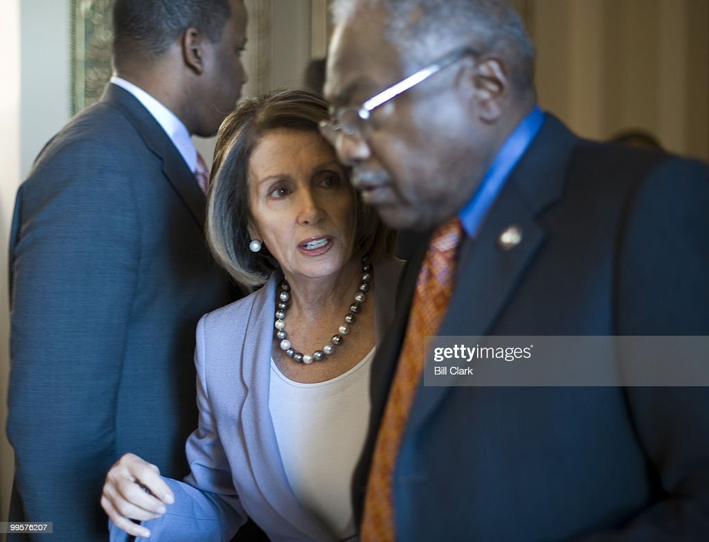 Speaker of the House Nancy Pelosi, D-Calif., and House Majority Whip James Clyburn, D-S.C., talk as they walk through the Will Rogers Corridor to the Speaker's office in the Capitol on Wednesday, Jan. 27, 2010.