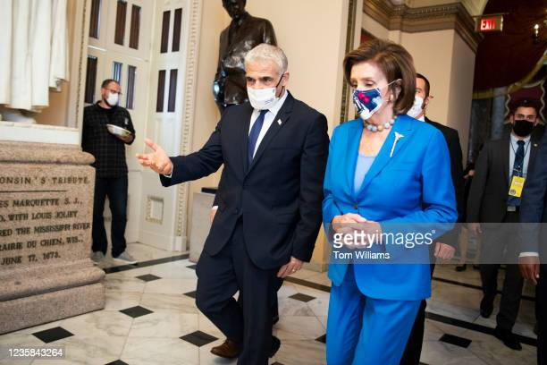 Speaker of the House Nancy Pelosi, D-Calif., and Israeli Foreign Minister Yair Lapid are seen before a meeting in the U.S. Capitol on Tuesday,...